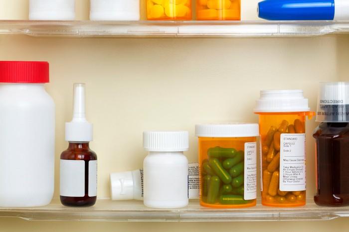 A medicine cabinet full of various bottles of medication.