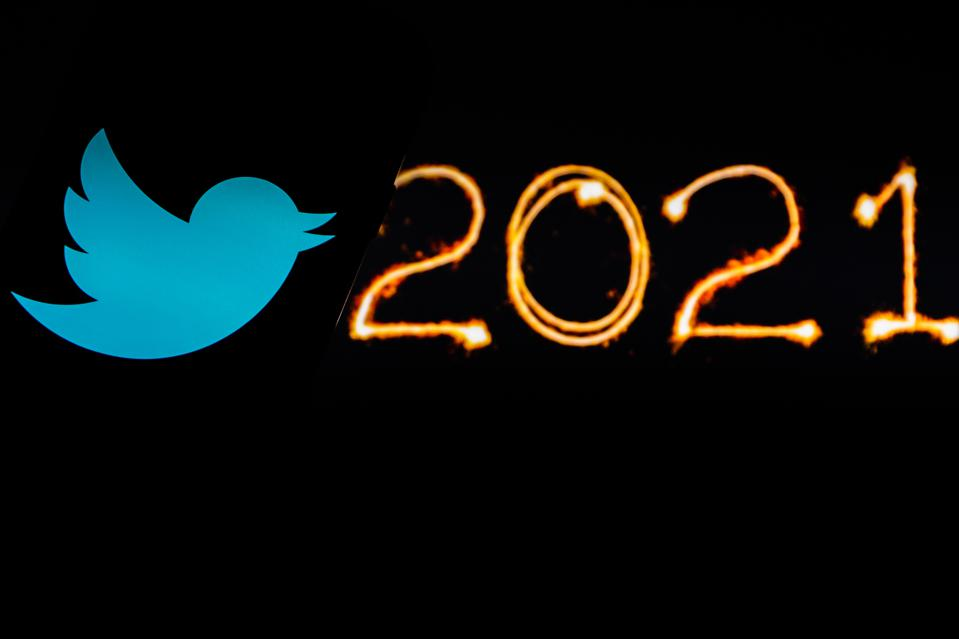 In this photo illustration a Twitter logo seen displayed on...