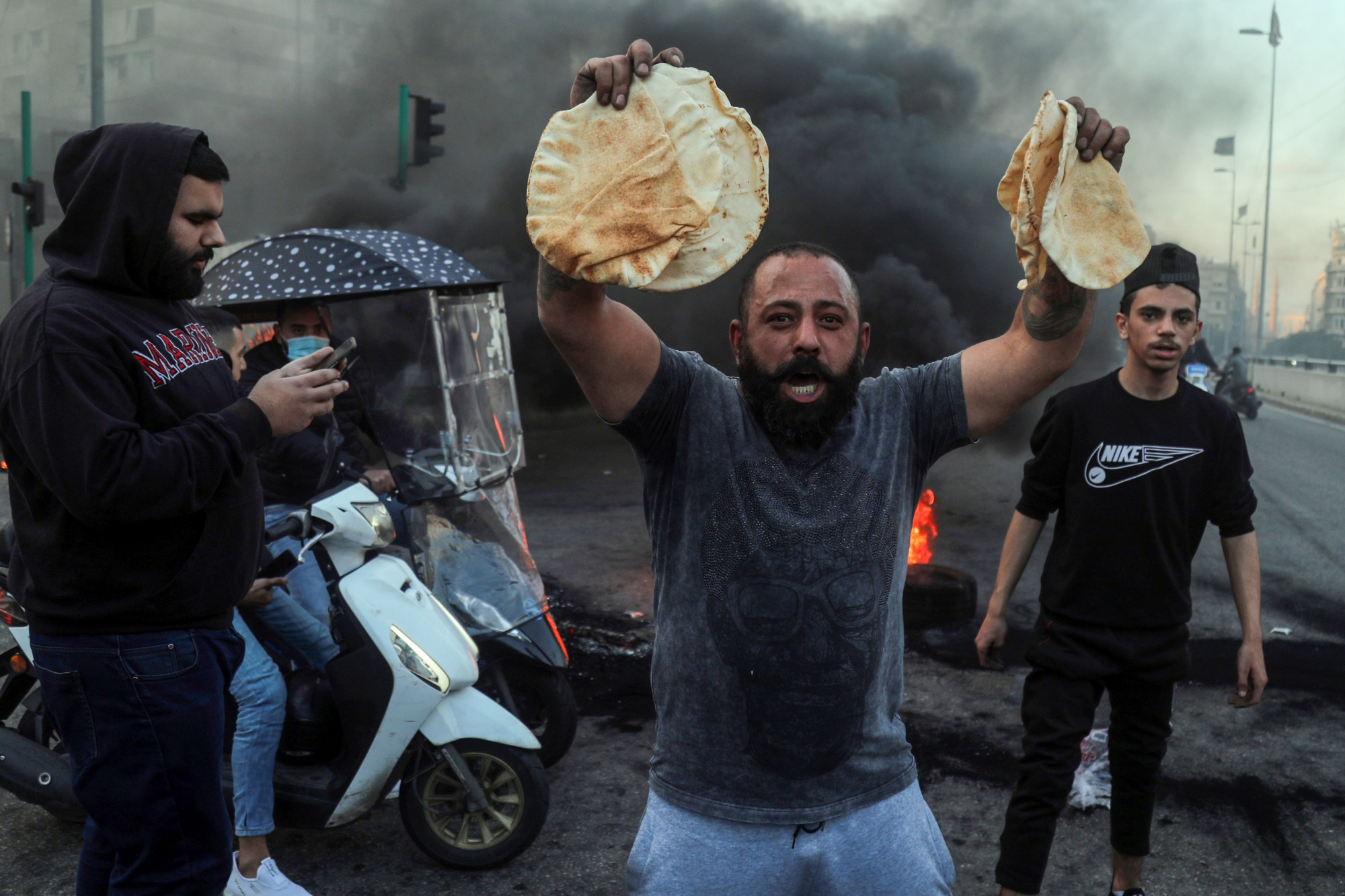A demonstrator holds government subsidized bread during a protest in Beirut, on March 2.