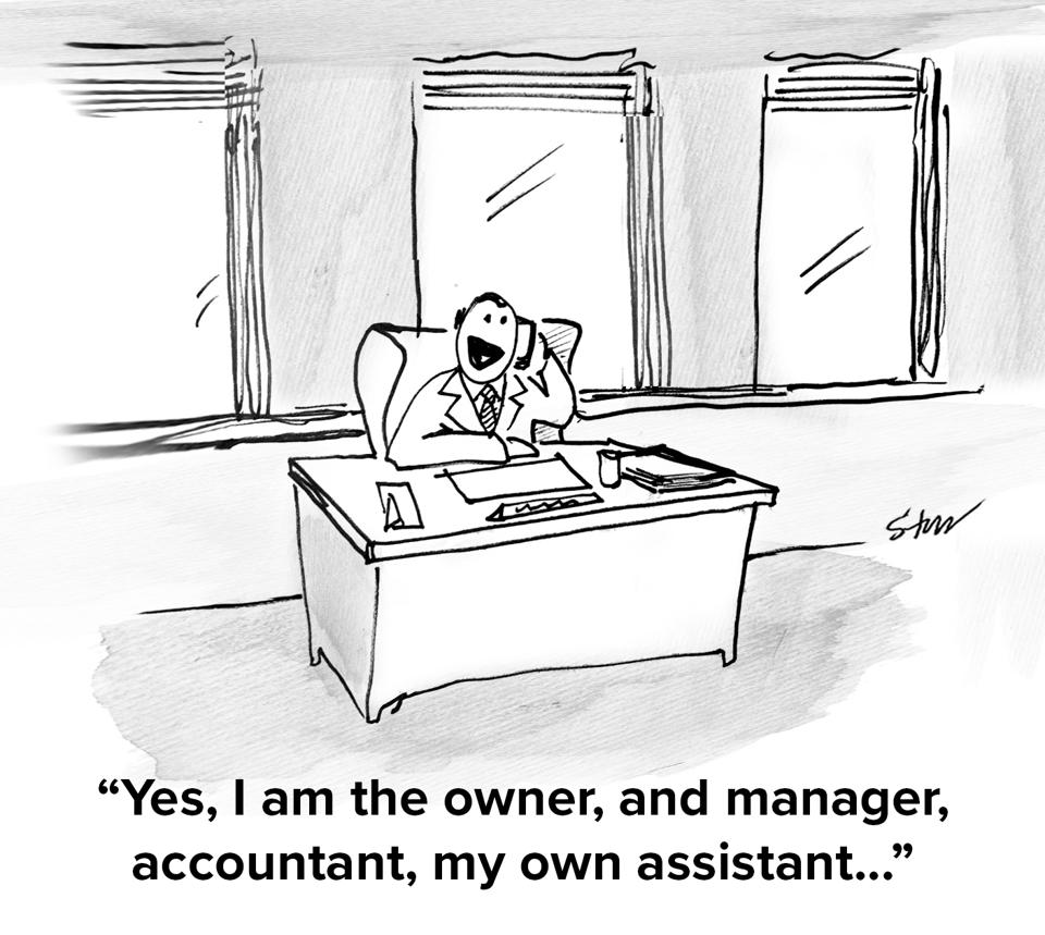 A business man sitting at a desk in an empty office alone on the phone saying ″Yes, I am the owner, and manager, accountant, my own assistant...″