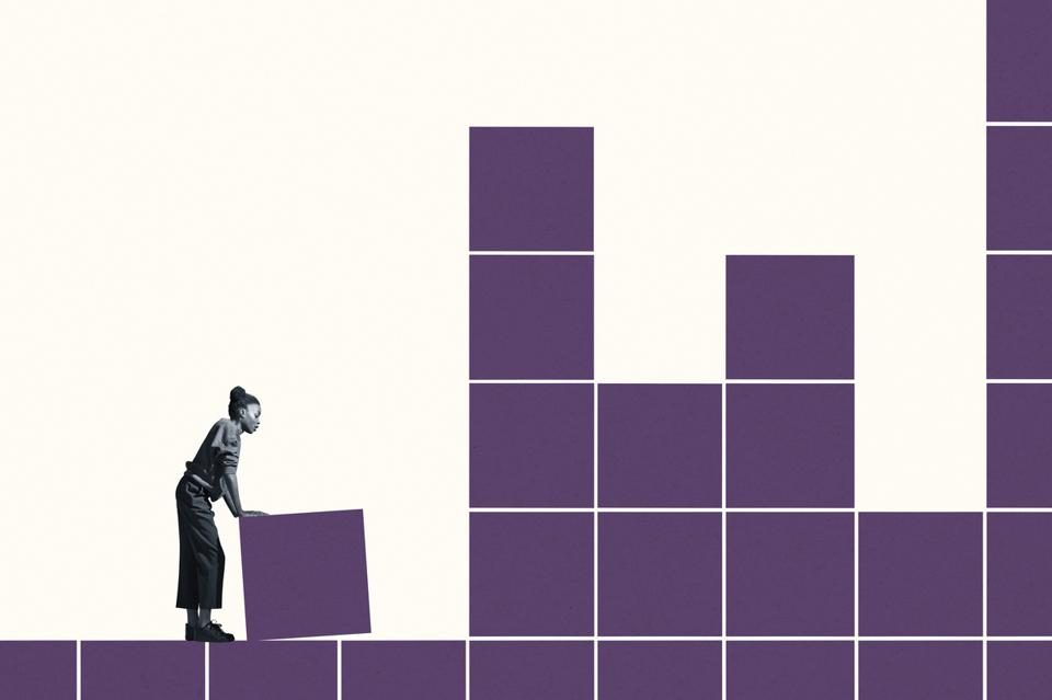 Young woman building grid with purple blocks